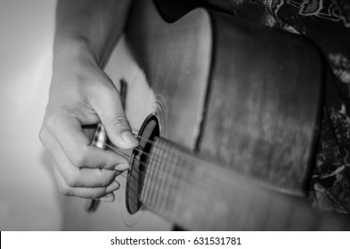 playing an acoustic guitar