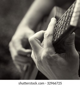 playing acoustic guitar, barre chord,
