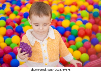 playing area for children. baby in a colorful coloring box