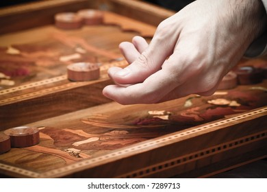 playing backgammon - focus on the hand with vintage effect
