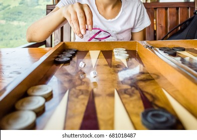 playing backgammon on a wooden table with dices