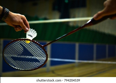 Playing Badminton On A Badminton Court