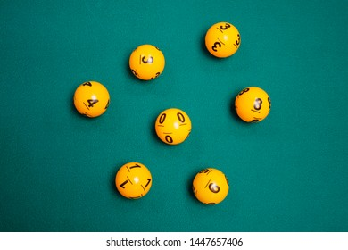 playing balls with number on green background for online casino concept