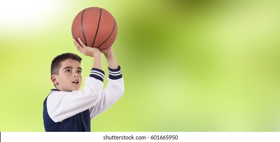 playing basketball, natural green background