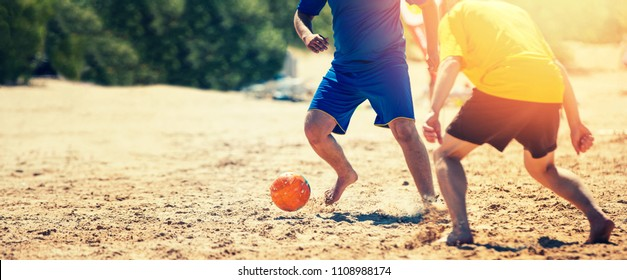 playing beach soccer