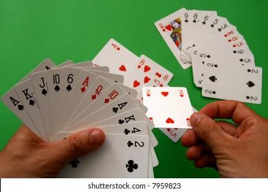 "playing bridge - one hand (A,K,J,10,6 spades, 2 heart, A,Q,10 diamonds, A,K,4,2 clubs),  on table other ""bridge hand"""