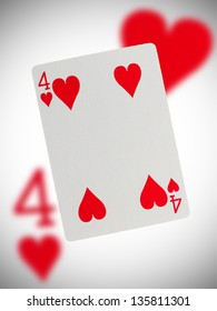 Playing card with a blurry background, four of hearts