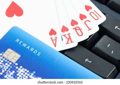 playing card and credit card on the computer keyboard, Online gamble concept