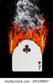 Playing card with fire and smoke, isolated on white - Ace of clubs