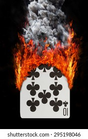 Playing card with fire and smoke, isolated on white - Ten of clubs