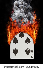 Playing card with fire and smoke, isolated on white - Seven of spades
