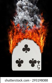 Playing card with fire and smoke, isolated on white - Five of clubs