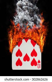 Playing card with fire and smoke, isolated on white - Ten of hearts