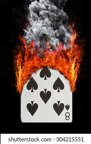 Playing card with fire and smoke, isolated on white - Eight of spades