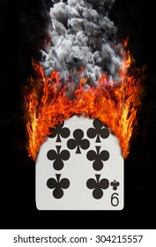 Playing card with fire and smoke, isolated on white - Nine of clubs