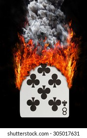 Playing card with fire and smoke, isolated on white - Eight of clubs