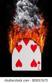 Playing card with fire and smoke, isolated on white - Seven of hearts