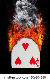Playing card with fire and smoke, isolated on white - Five of hearts