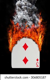 Playing card with fire and smoke, isolated on white - Three of diamonds