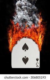 Playing card with fire and smoke, isolated on white - Three of spades