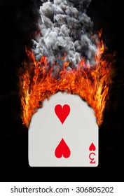 Playing card with fire and smoke, isolated on white - Three of hearts