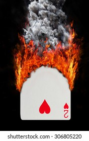 Playing card with fire and smoke, isolated on white - Two of hearts
