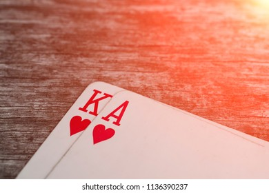 Playing card, game abstract: Ace and king of hearts