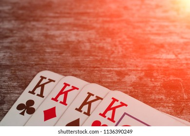 Playing card, game abstract: four king