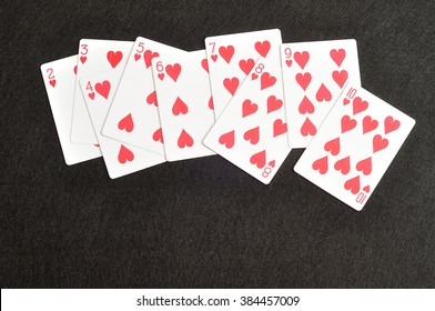 Playing card. Two to ten of hearts isolated on a black background