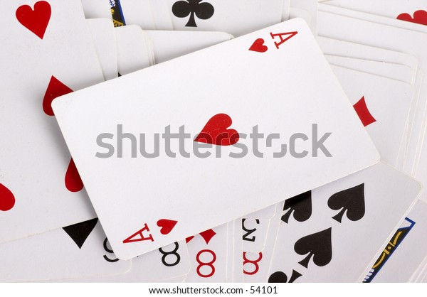 Playing cards with ace of hearts on top