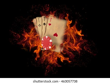Playing cards and chips on fire. casino concept.