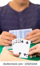 Playing cards closeup of hands holding deck cuarenta traditional Ecuadorian game selective focus