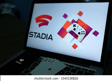 Playing cards and computer screen with the Stadia logo which is a subscription service for video games in the cloud operated by Google. United States, California. Wednesday, October 30, 2019