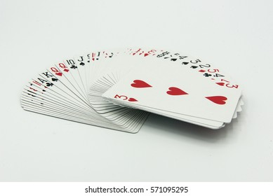 Playing cards deck in a fan spread isolated on a white background - red and black colors, used to play black jack or poker