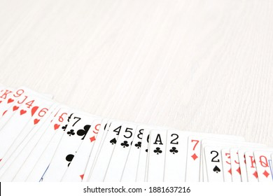 Playing cards, deck of cards on a white table, copy space. The concept of gambling, competition.