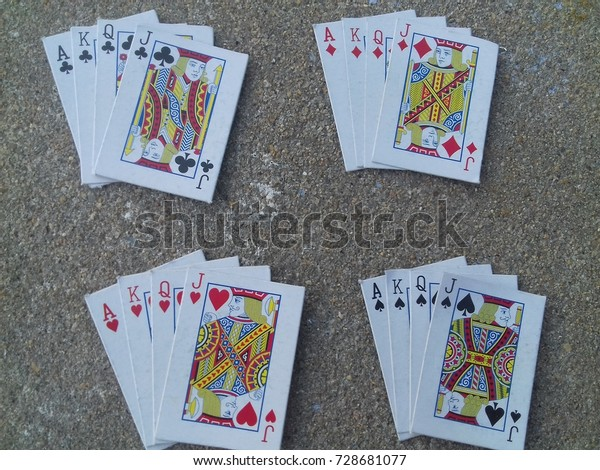 playing cards, deoli, tonk, rajasthan, india, 5th October 2017: ace, king, queen and jack in allfour suites in playing cards on concrete floor.