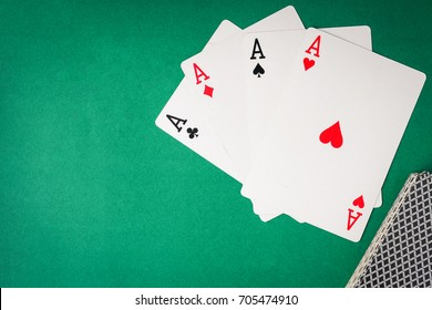 Playing cards, Four aces on green background. Free space for text