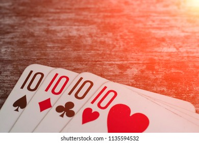 Playing cards, game abstract: four ten