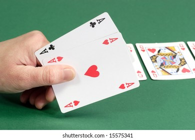 Playing cards on green background. Shot in studio.