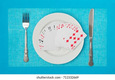 Playing cards on a plate