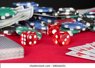 playing cards on a red poker table close-up