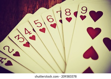 Playing cards on wooden background,playing cards for valentines day