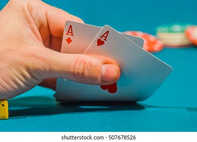 playing cards in a people hand