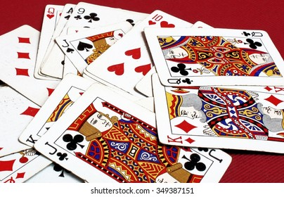 Playing Cards Scattered On A Red Background