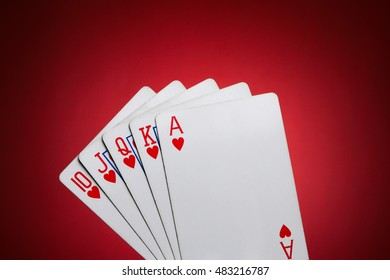 playing cards showing a Royal Flush of Hearth
