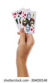 Playing cards three Kings in female hand isolated on white background