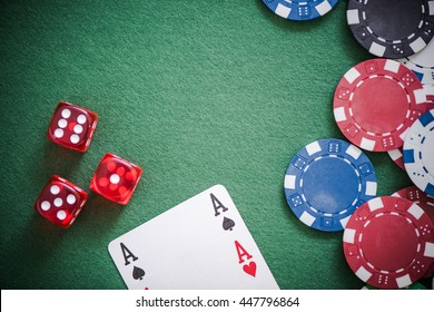 playing cards,dices and poker chips from above on green poker table