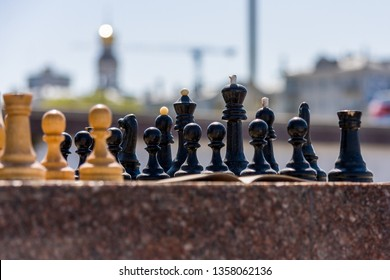 playing chess in the street. on the background of the city. sunny summer day