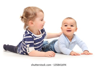 Playing children. An girl with her little brother on a white background.