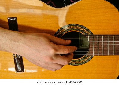 Playing a classical guitar